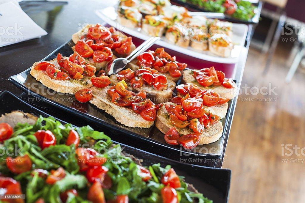Aperitif with Fresh Bruschetta, Tomato and Salad stock photo