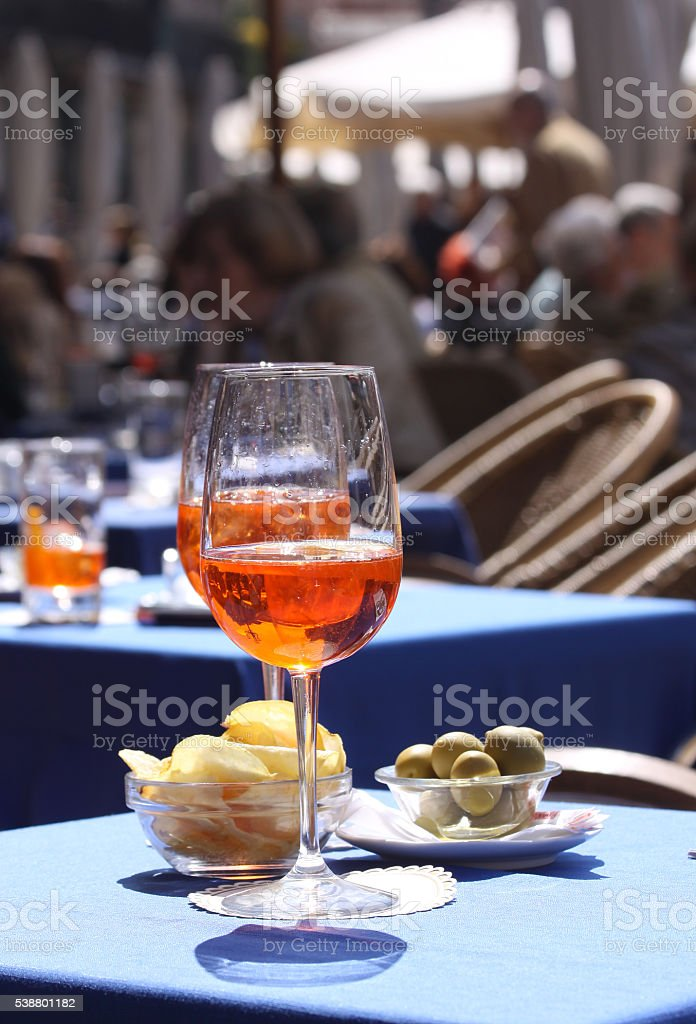 Aperol glasses at an outdoor cafe in Verona stock photo