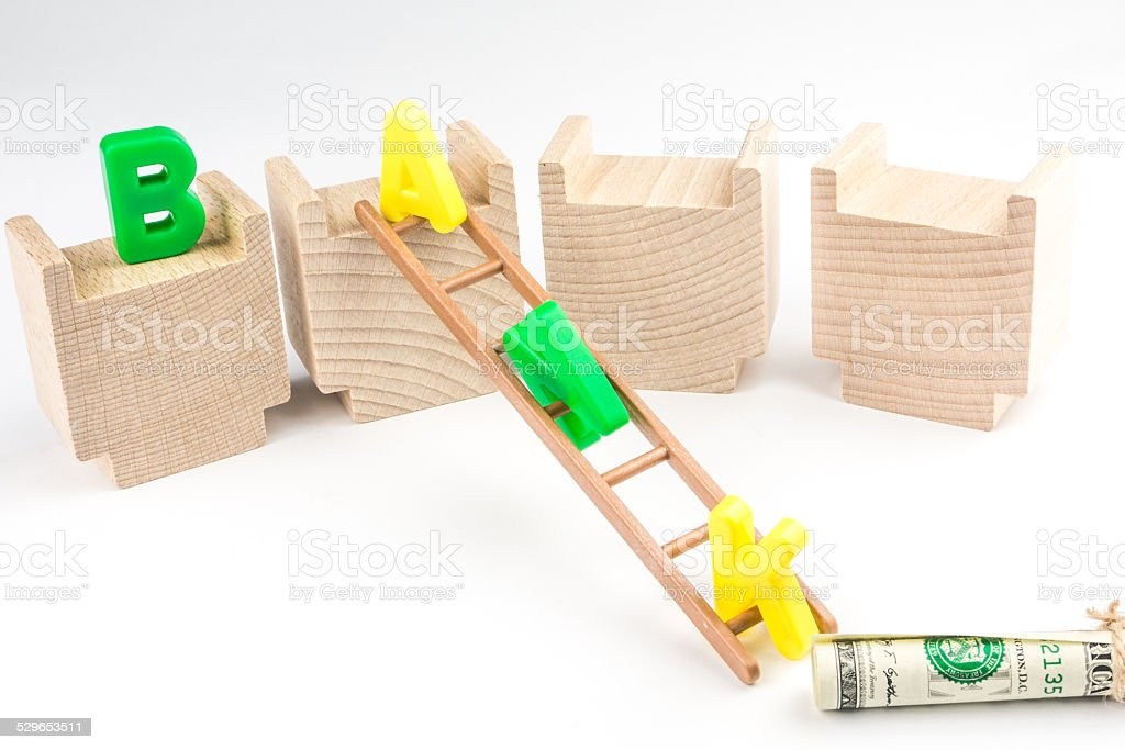 apital letters of BANK escaping on a ladder from building stock photo