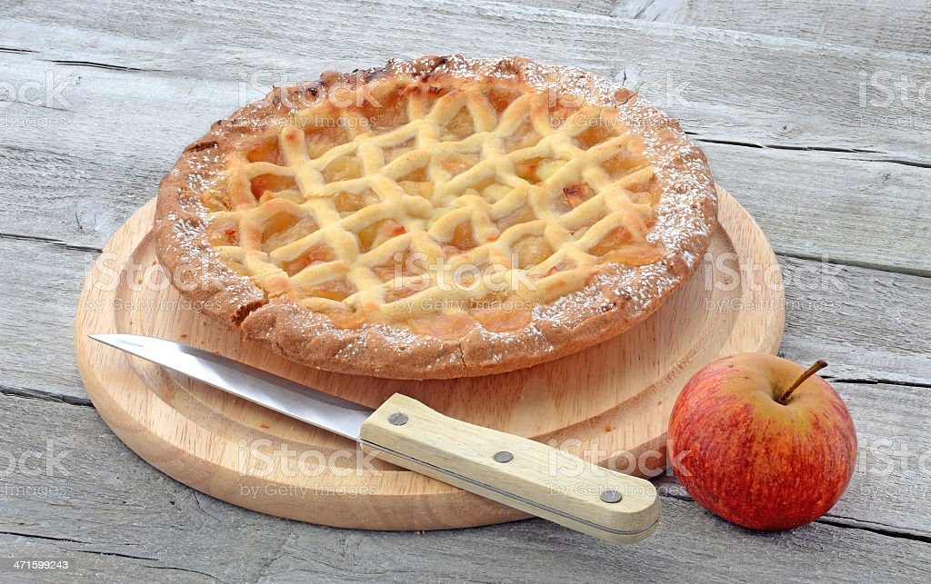 Aplle pie on cutting board royalty-free stock photo