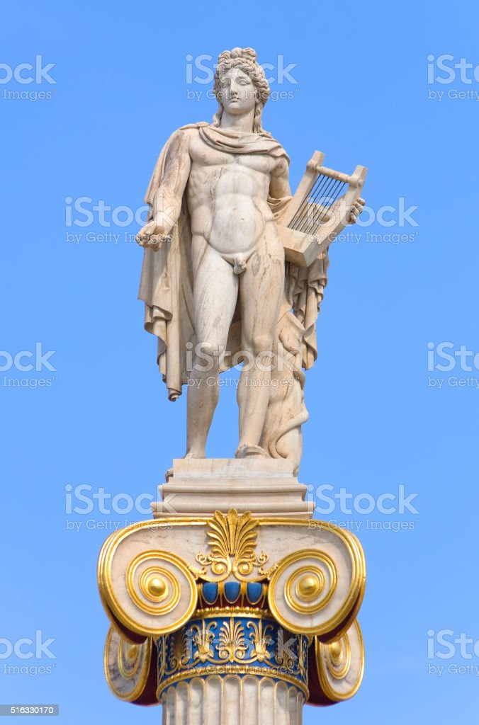 Apollo statue with golden decorations stock photo
