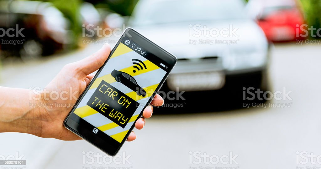 App on smart phone connects to a car or taxi stock photo