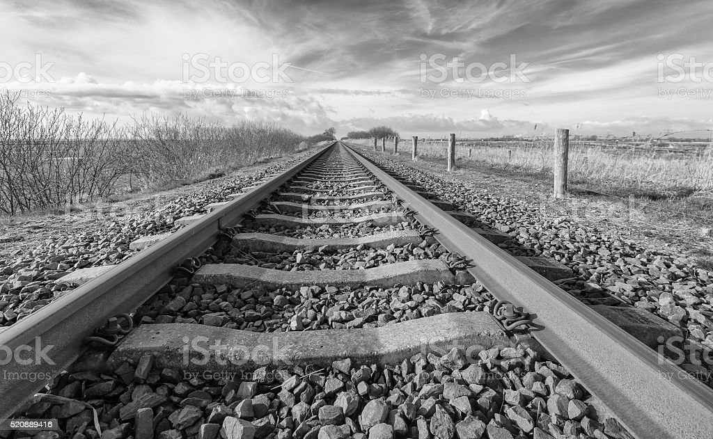Apparently endless rusty train rails stock photo