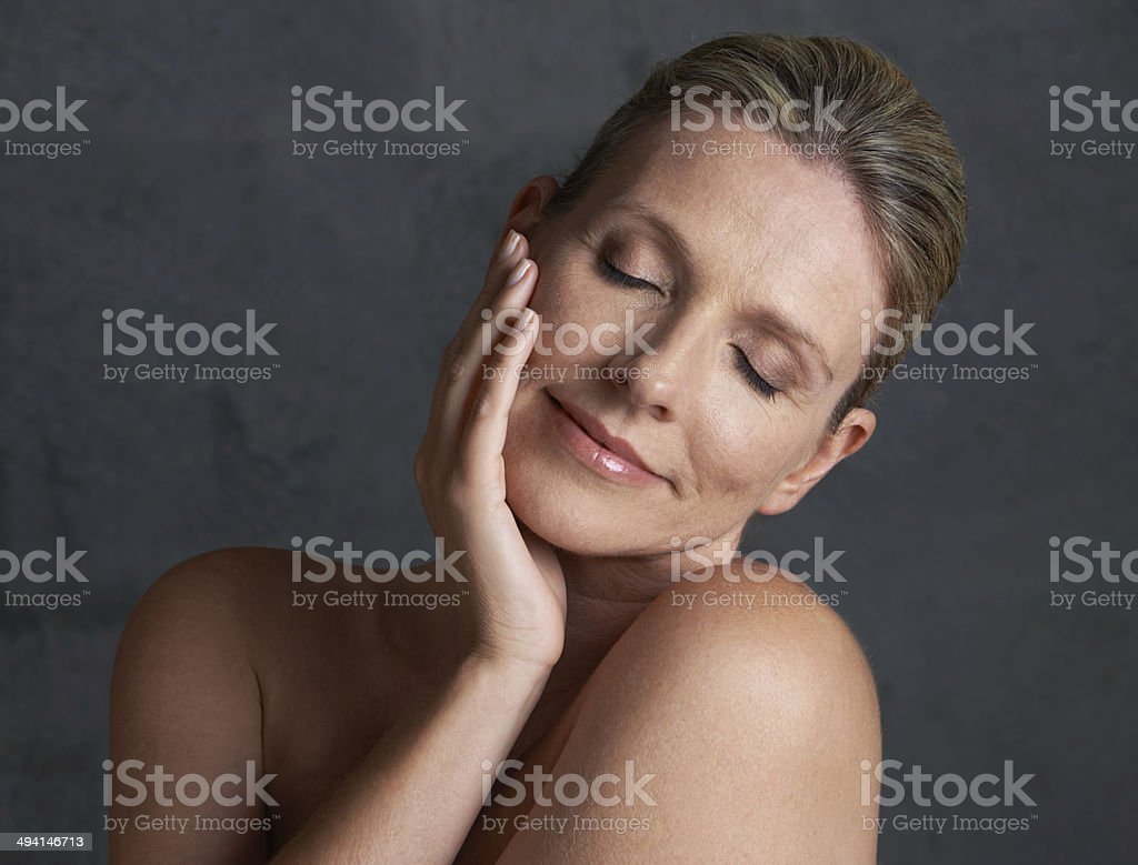 Appeased by her own skin stock photo