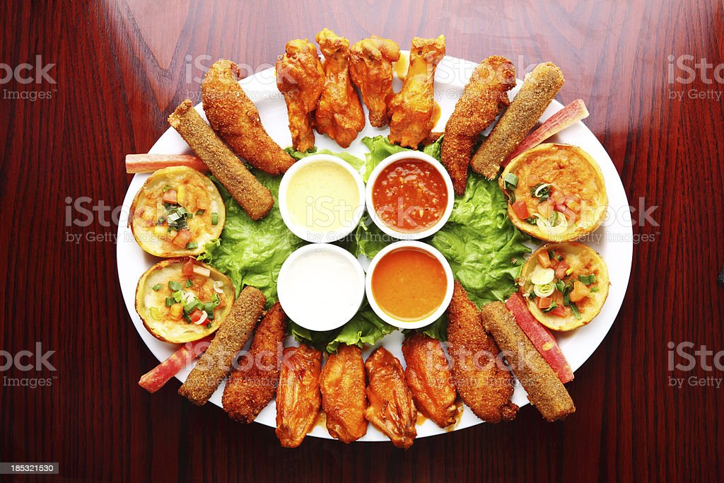Appetiser Platter Grilled Buffalo Chicken Wings, Potato Skins stock photo