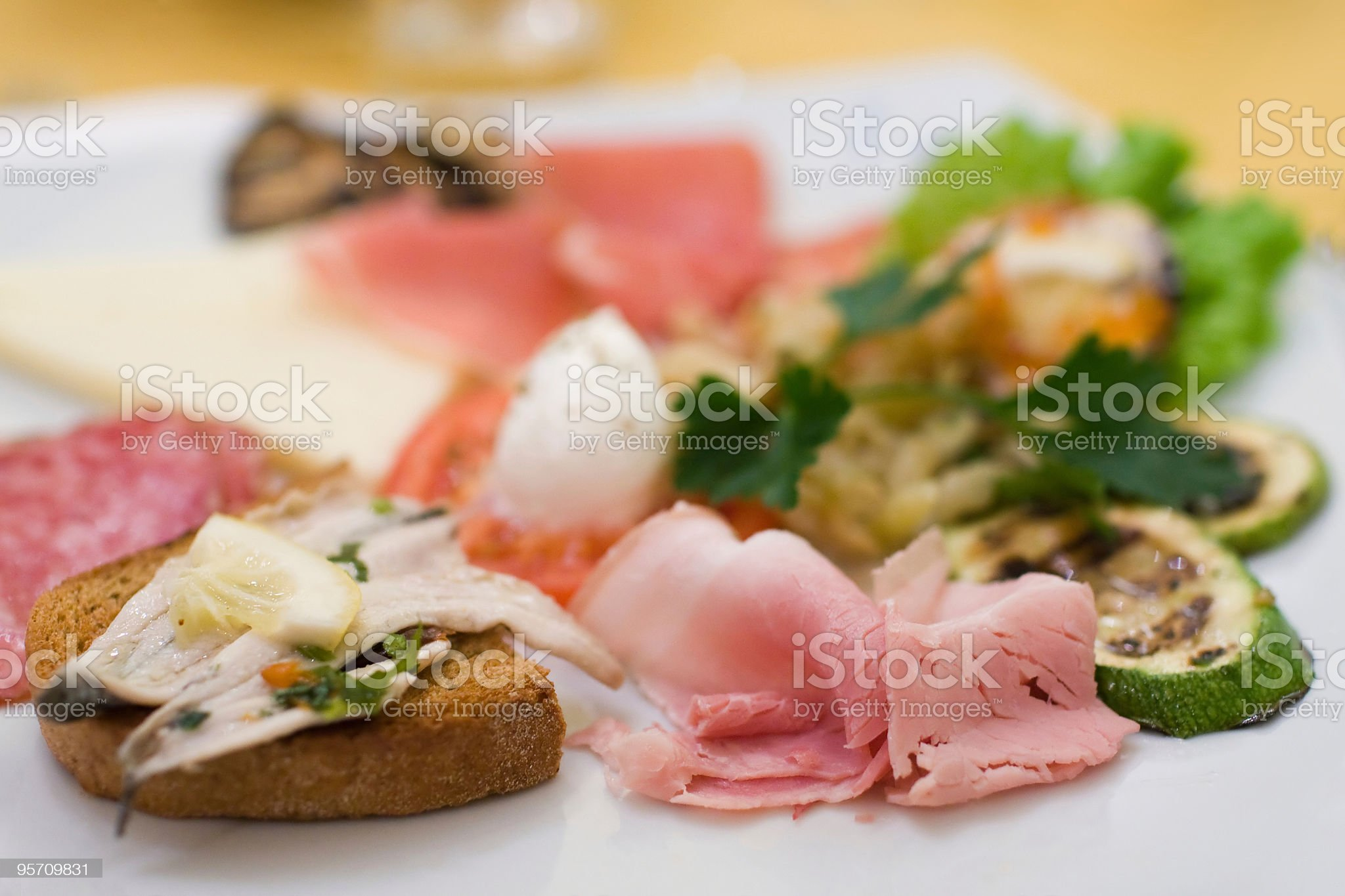 Appetising mixed starters on a white plate (shallow DOF) royalty-free stock photo