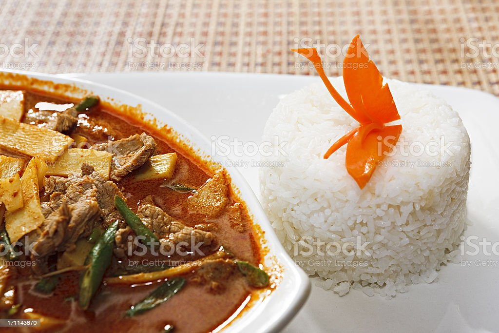 Appetising Thai red beef curry with carved carrot butterfly royalty-free stock photo