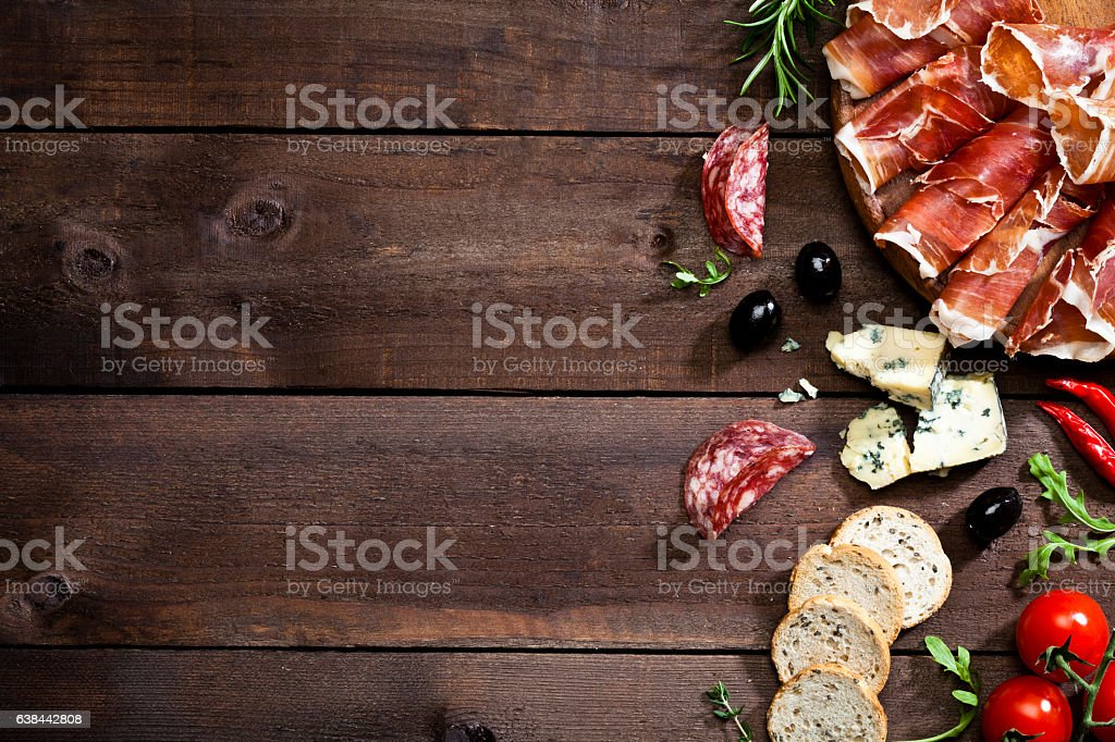 Appetizer border on rustic wood table stock photo