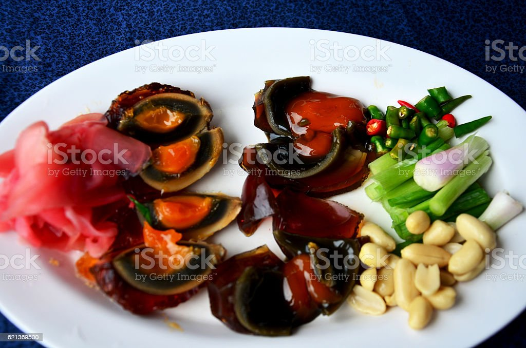 Appetizer century egg with side dish stock photo
