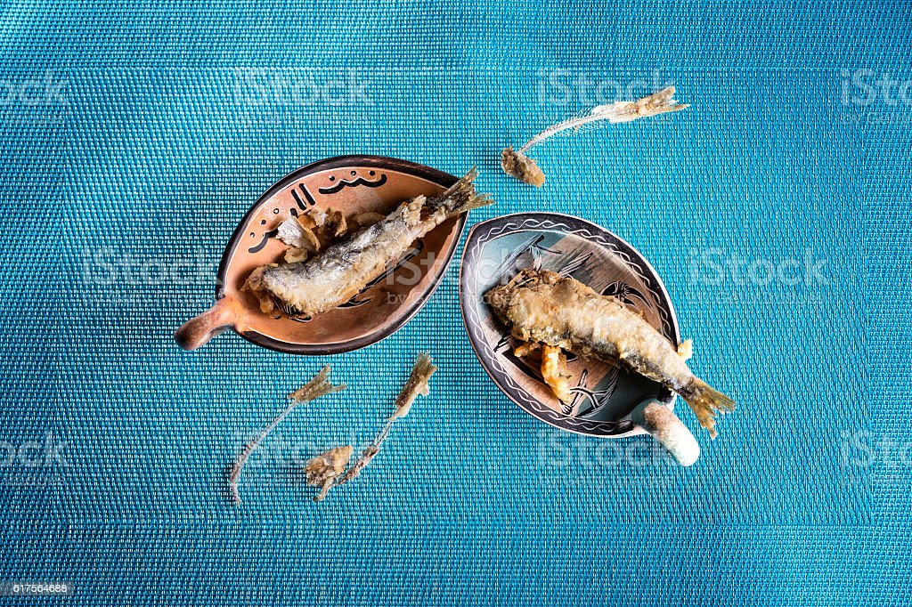 Appetizer fried sardines and fish bone stock photo