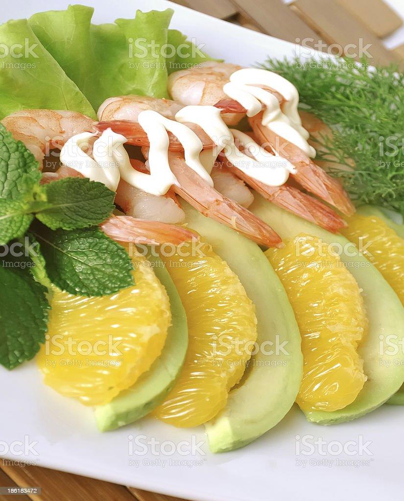 Appetizer of avocado, shrimp with orange stock photo
