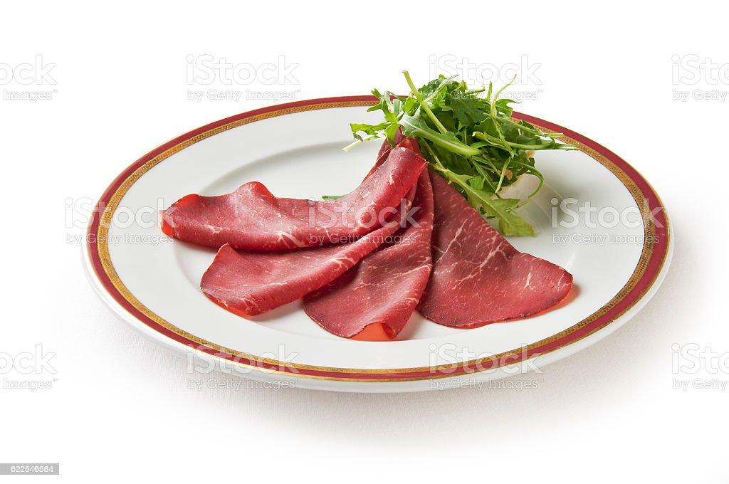 Appetizer of bresaola and arugula stock photo