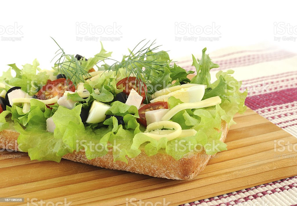 Appetizer of chicken with egg and olives on ciabatta royalty-free stock photo