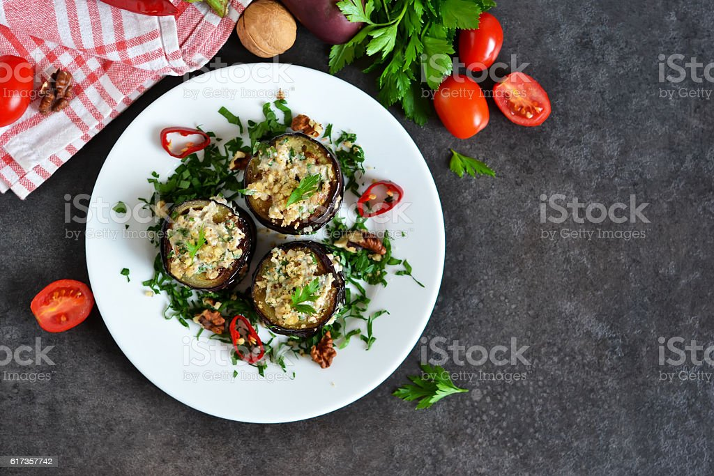 Appetizer of eggplant and nut sauce, cilantro and garlic stock photo