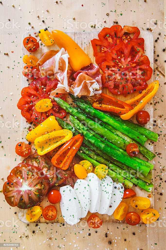 Appetizer plate - grilled vegetables with jamon and Mozzarella cheese stock photo