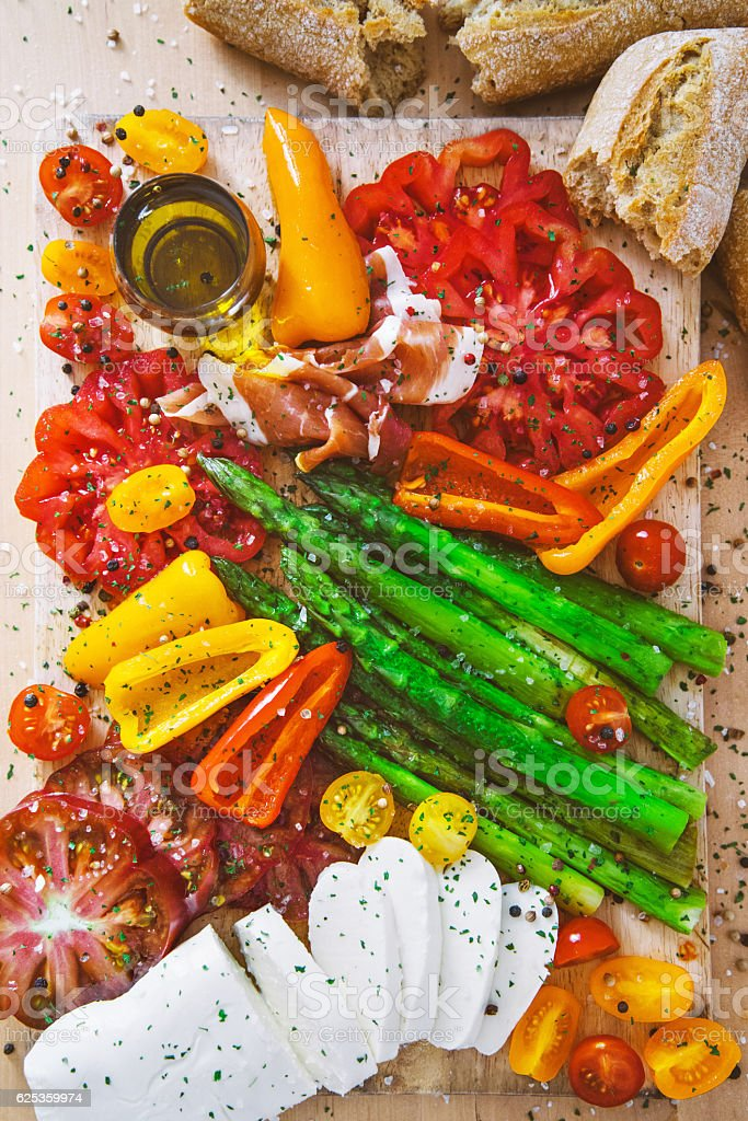 Appetizer plate - grilled vegetables with prosciutto and Mozzarella cheese stock photo