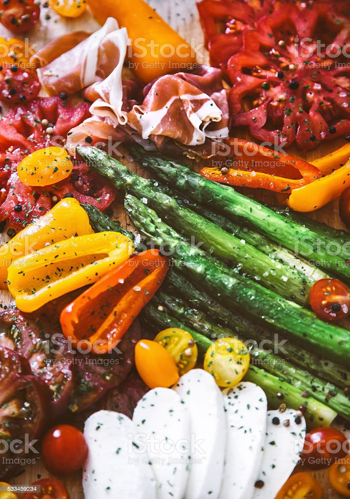 Appetizer plate - grilled veggies with jamon and Mozzarella cheese stock photo