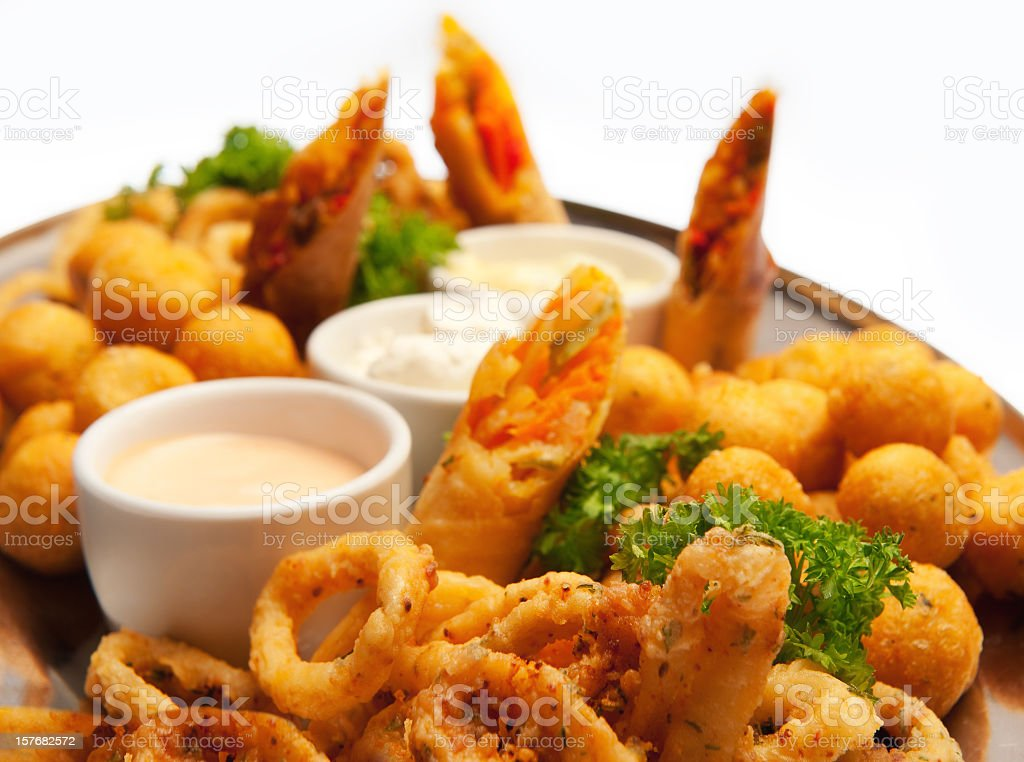 Appetizer plate with friend calamari, cheese and taquitos royalty-free stock photo
