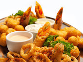 Appetizer plate with friend calamari, cheese and taquitos