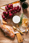 appetizer with cheese, grapes, wine, honey and bread