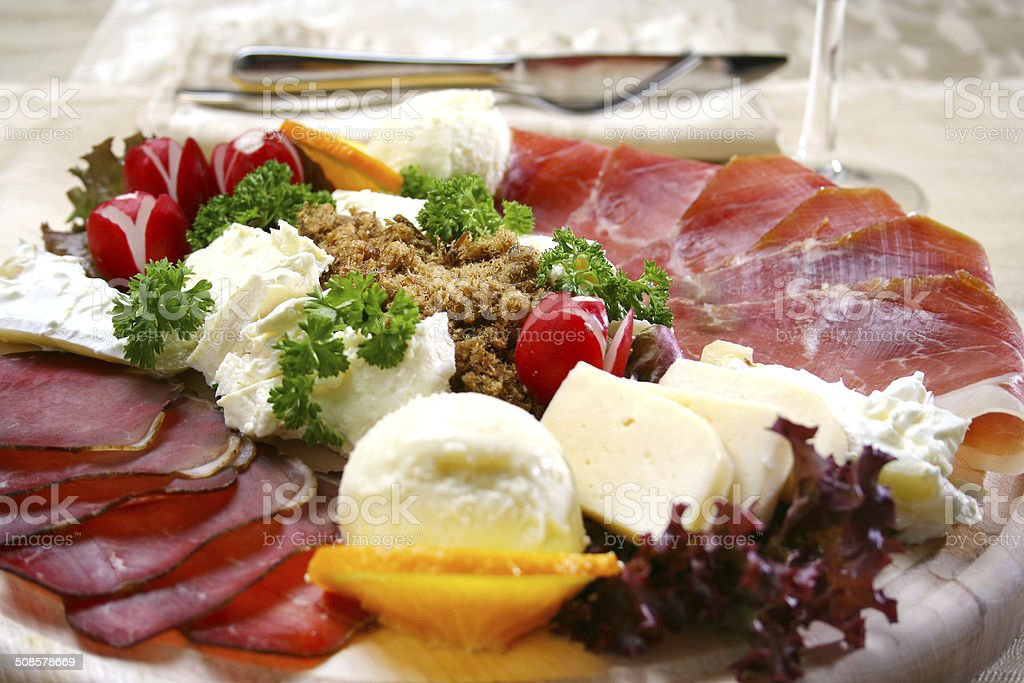 appetizer with ham on wooden board and cheese stock photo