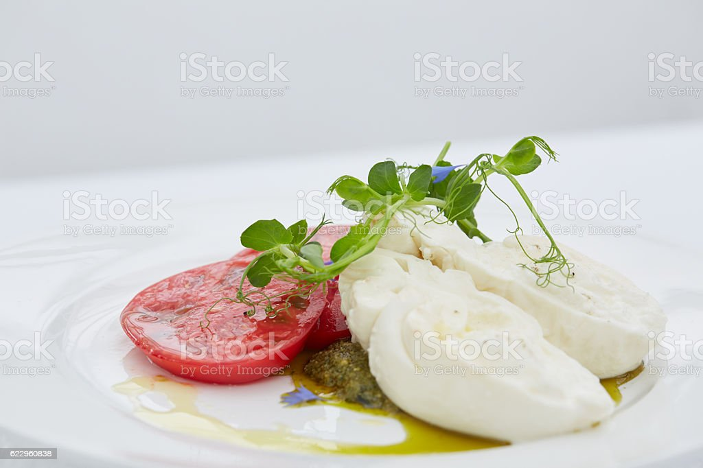 appetizer with tomato and cheese stock photo