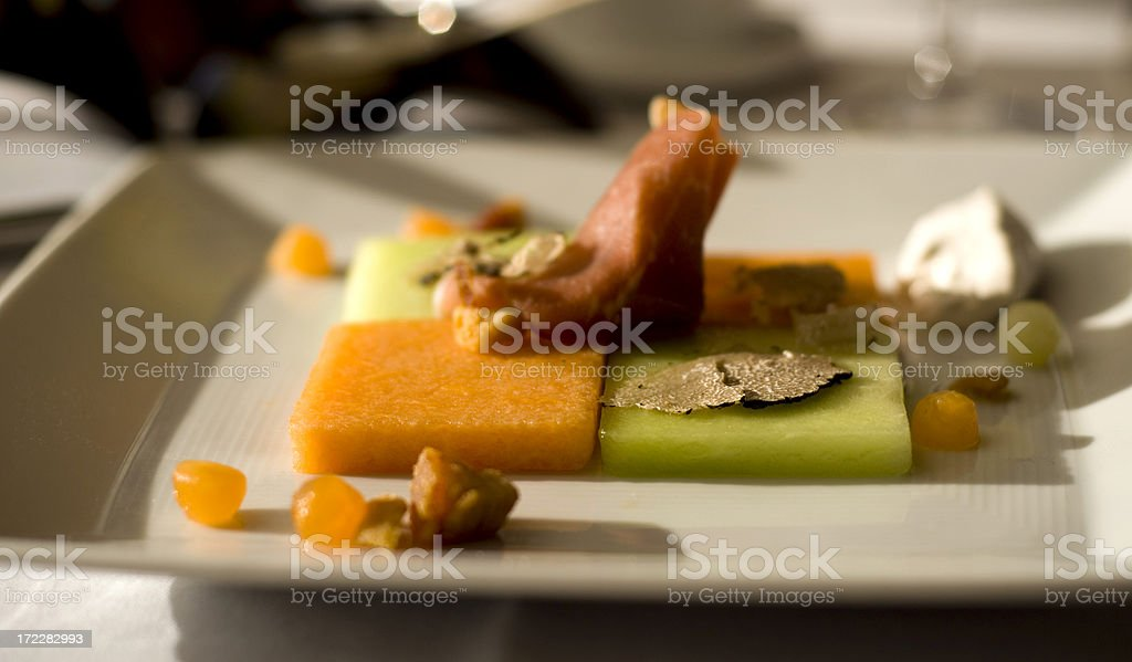 Appetizer...Melon, Proscuitto Ham, and Truffles! royalty-free stock photo