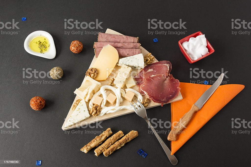 Appetizers and cheese plate royalty-free stock photo