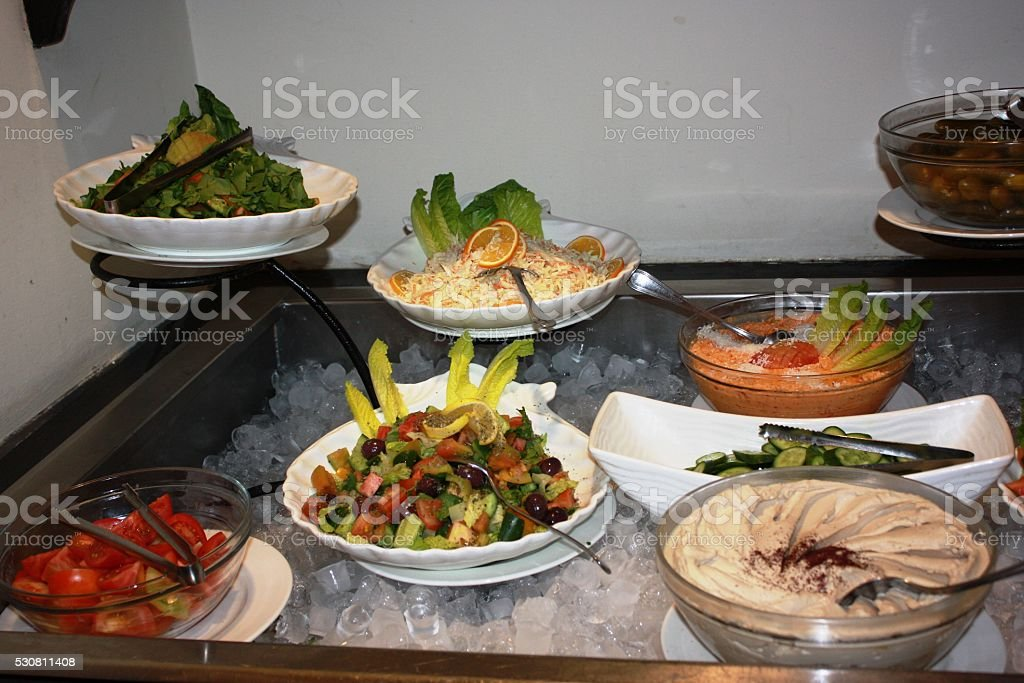 Appetizers buffet with hummus and salad stock photo