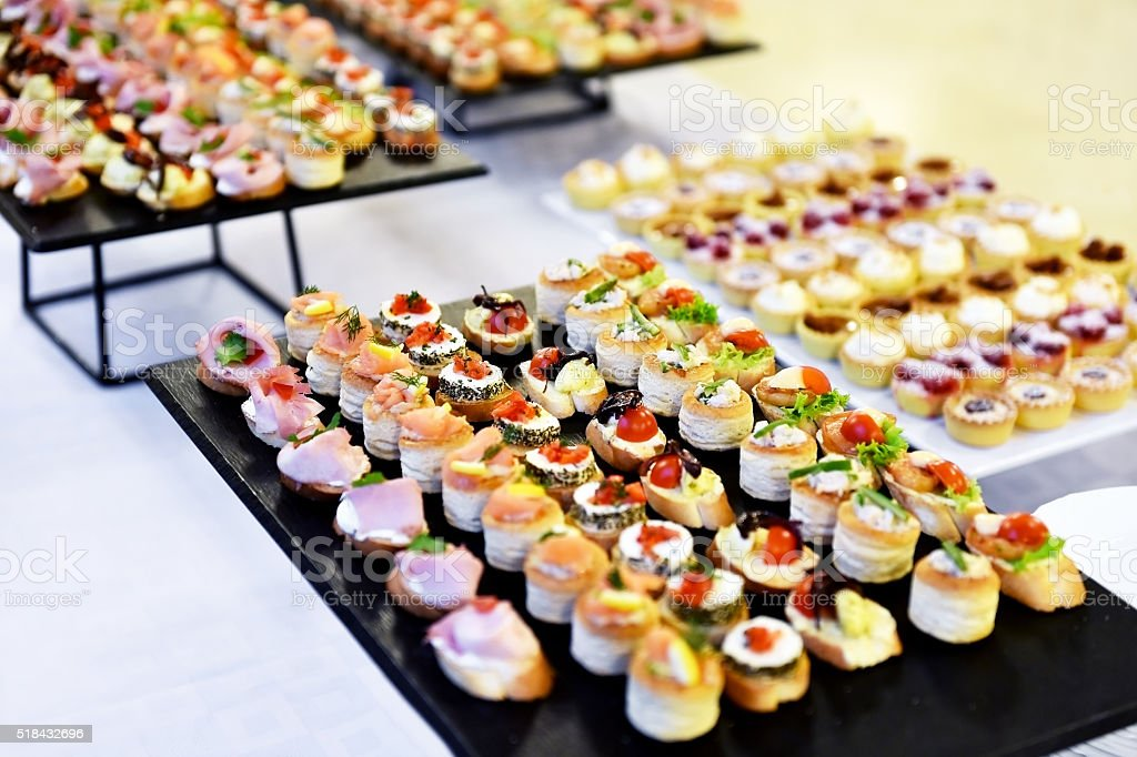 Appetizers on plates ready for eat stock photo