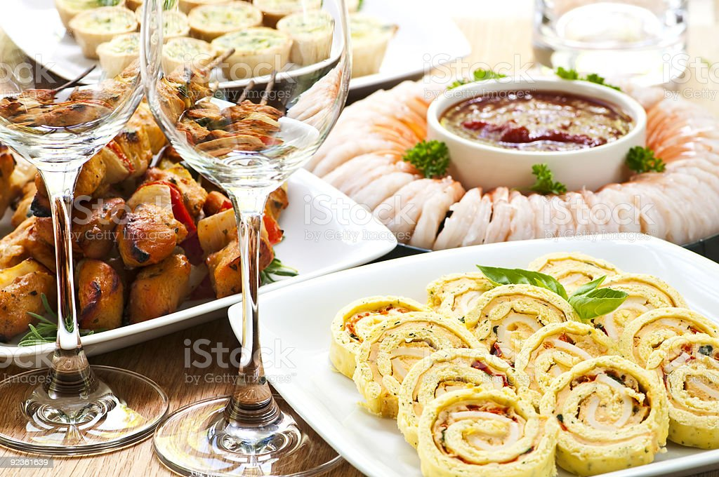 Appetizers ready to be served with wine at a party stock photo