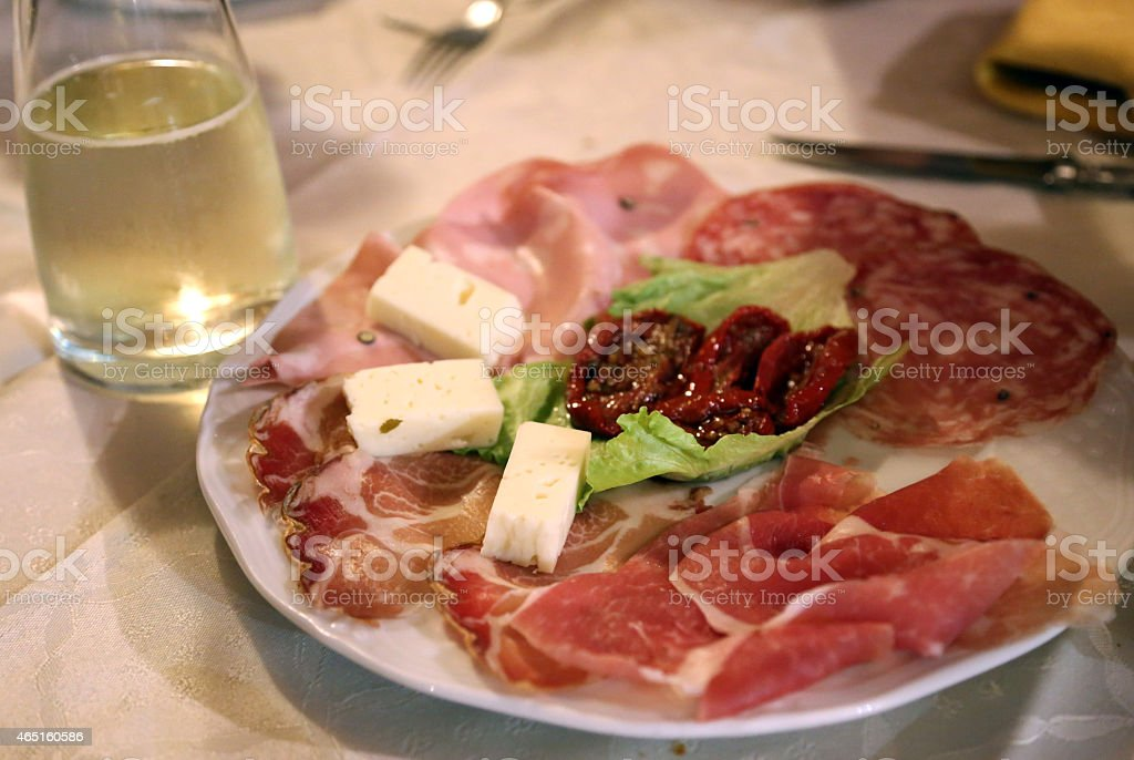 appetizers with Italian salami at the restaurant stock photo
