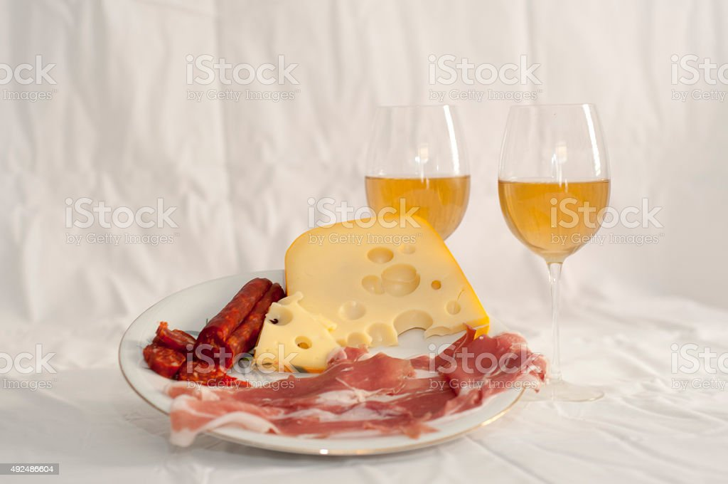 Appetizers with white wine stock photo