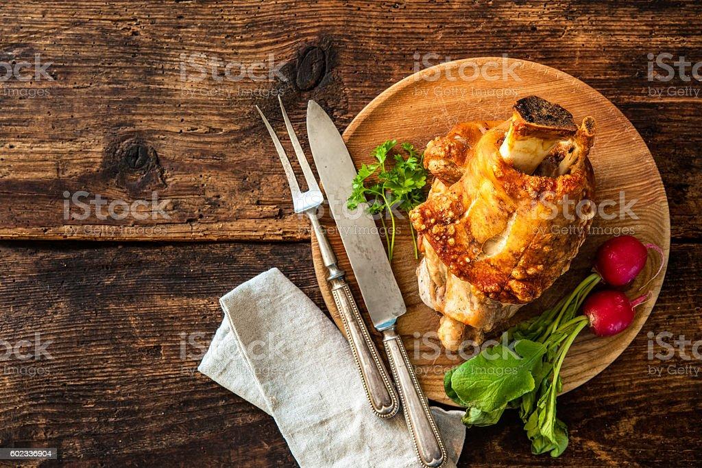 Appetizing Bavarian grilled pork knuckle stock photo