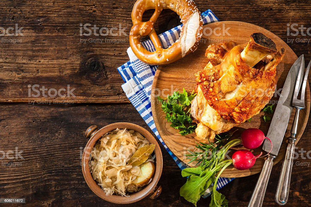 Appetizing Bavarian grilled pork knuckle with sauerkraut stock photo