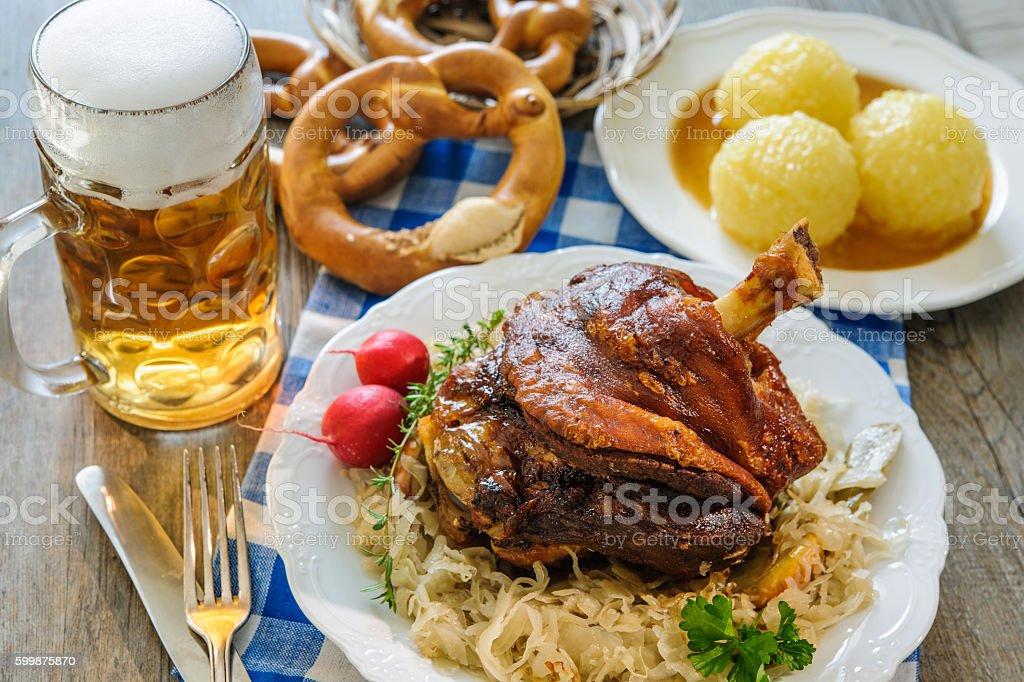 Appetizing Bavarian roast pork knuckle stock photo