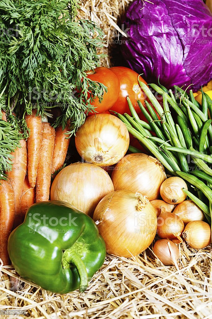 Appetizing, colorful fresh produce on straw at farmers market royalty-free stock photo