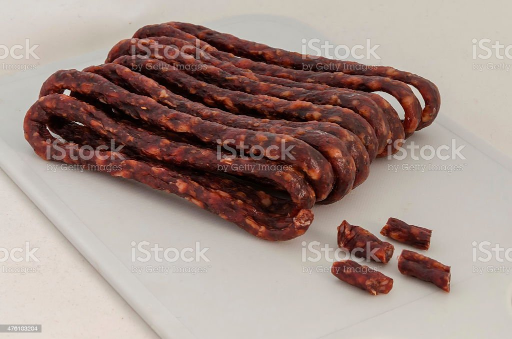 Appetizing dried spicy hunting  sausages stock photo