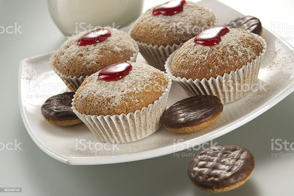 Appetizing fruitcakes and chocolate cookies royalty-free stock photo