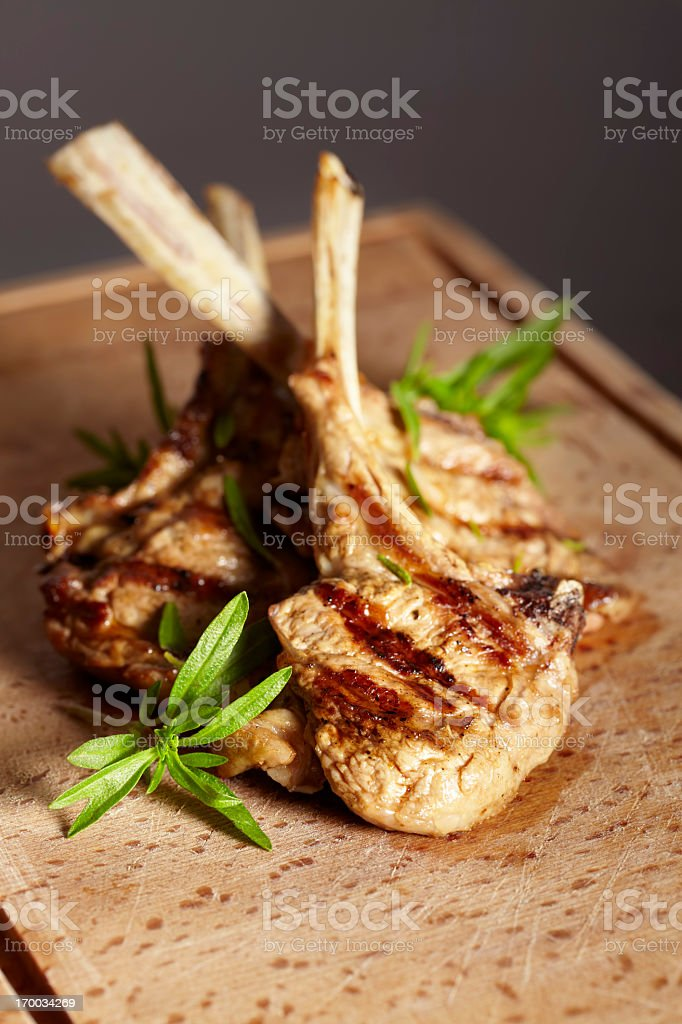 Appetizing grilled cutlets on a wooden cutting board. stock photo