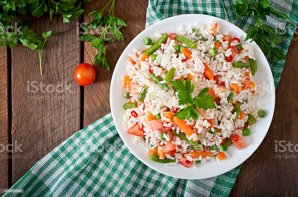 Appetizing healthy rice with vegetables stock photo