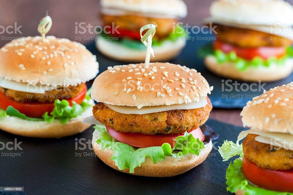 Appetizing mini chicken burgers. stock photo