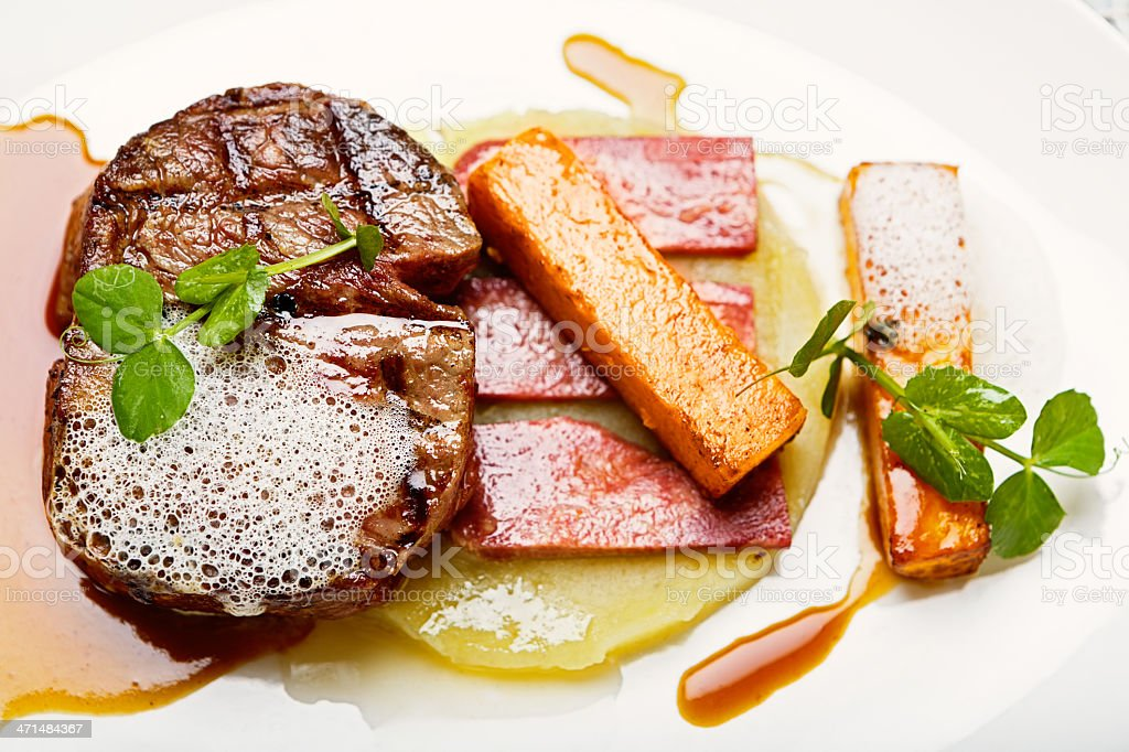 Appetizing overhead view of grilled fillet steak and accompaniments stock photo
