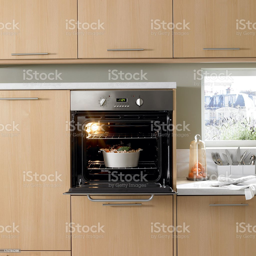 Appetizing roast turkey casserole in the oven for thanksgiving day stock photo