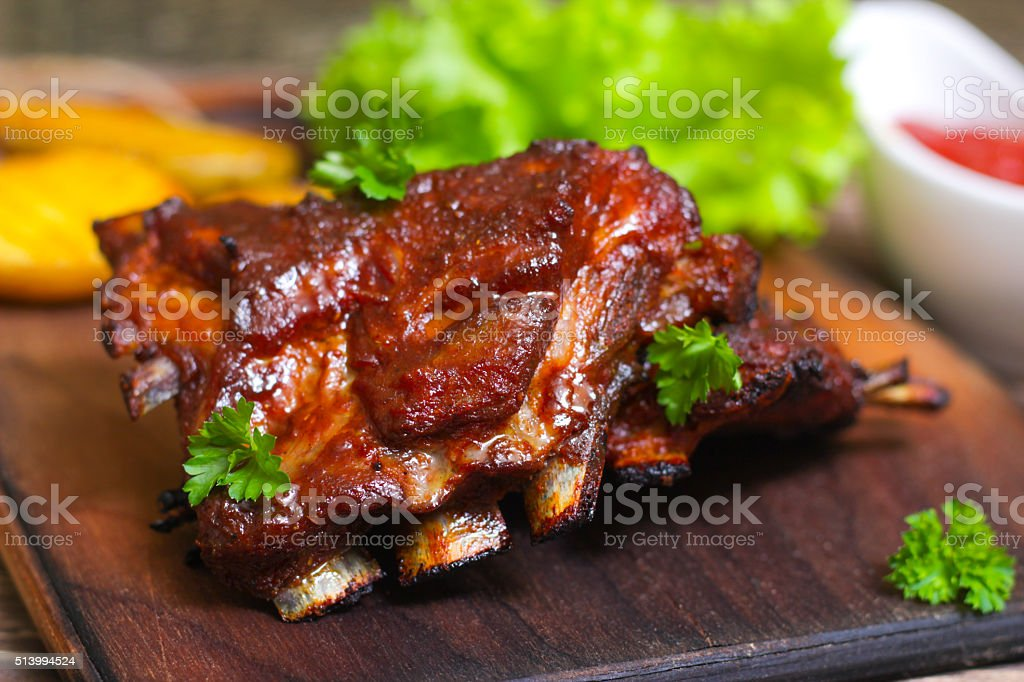 Appetizing rosy and barbecued lamb ribs seasoned stock photo