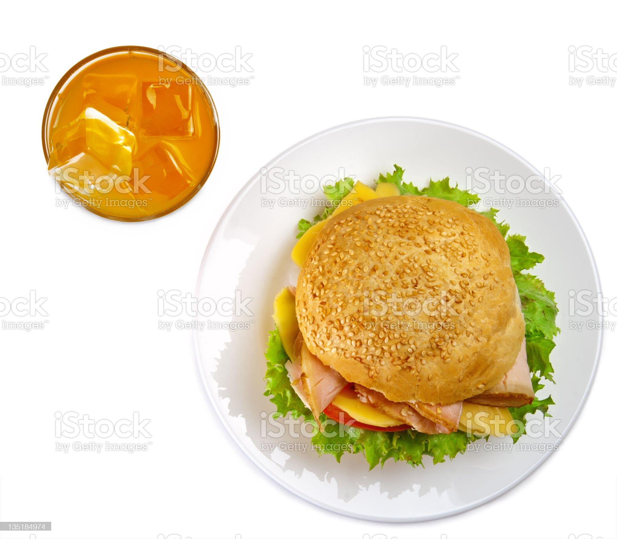 Appetizing sandwich and glass of orange juice royalty-free stock photo