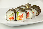 appetizing vegetarian rolls with vegetables on the plate on  whi