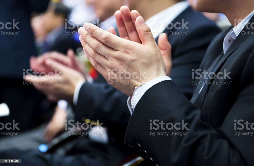 applauding at meeting stock photo