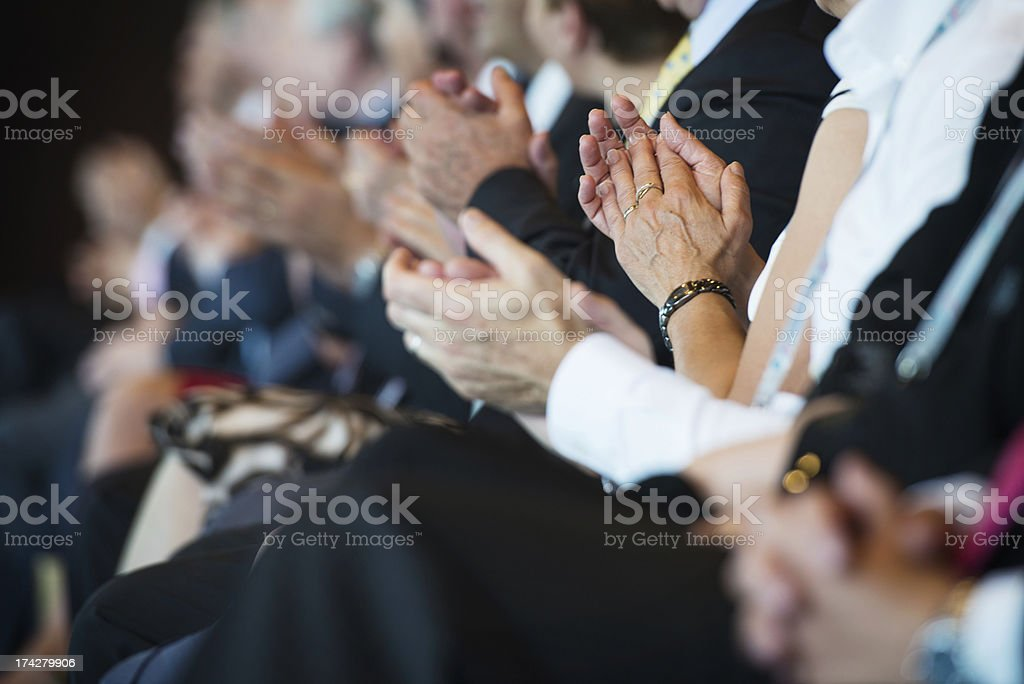 Applauding businesspeople in a row stock photo