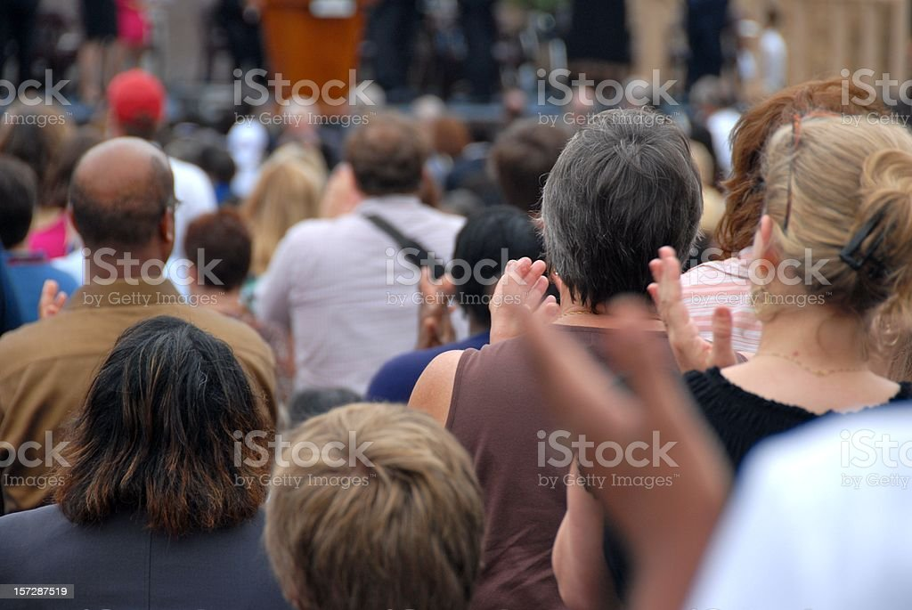 Applauding enthusiastic crowd at a public event royalty-free stock photo